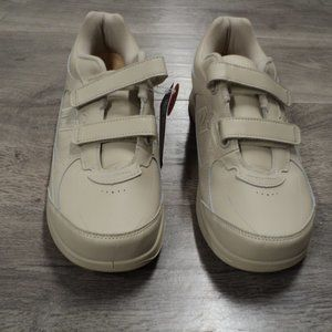 Men's New Balance tan walking  shoes with Velcro straps . Size 11